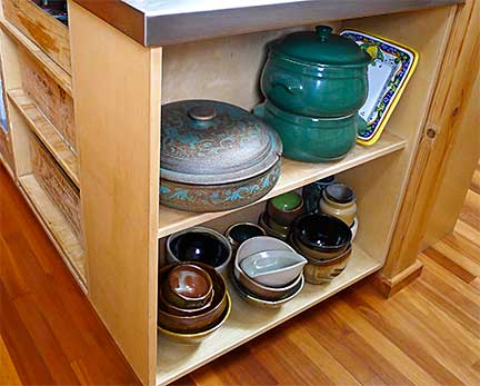 Lyptus Flooring. Pottery on Lower Shelf Made by Otto Gilbert