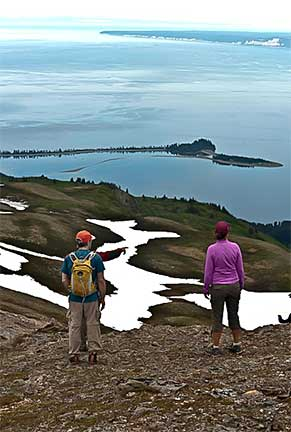 Hikers Looking Down on McDonald Spit