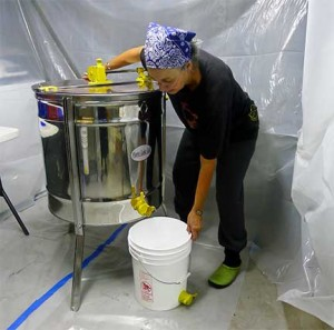 Beverly Barker Getting Ready to Drain Honey from Extractor