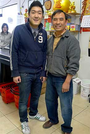 Owner Barry Yu and nephew Barry Kwan working at Lucky Market in ANC